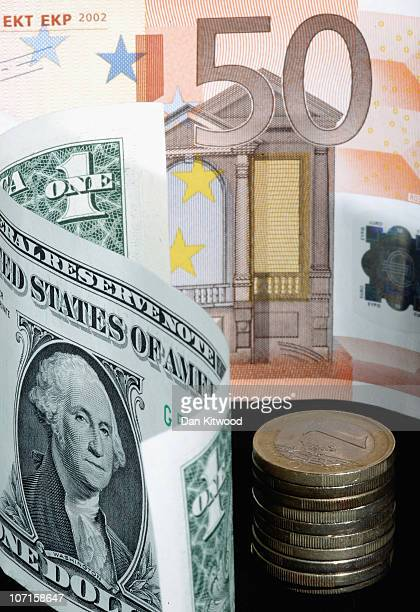 In this photo illustration a Dollar note is displayed next to Euro notes and coins on November 26 2010 in London England Concerns over the Euro zone...