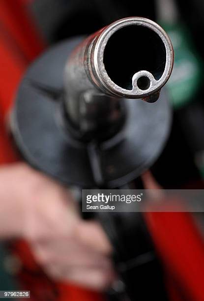 In this photo illustration a drop of gasoline clings to a gasoline pump nozzle at a filling station on March 23 2010 in Berlin Germany German...