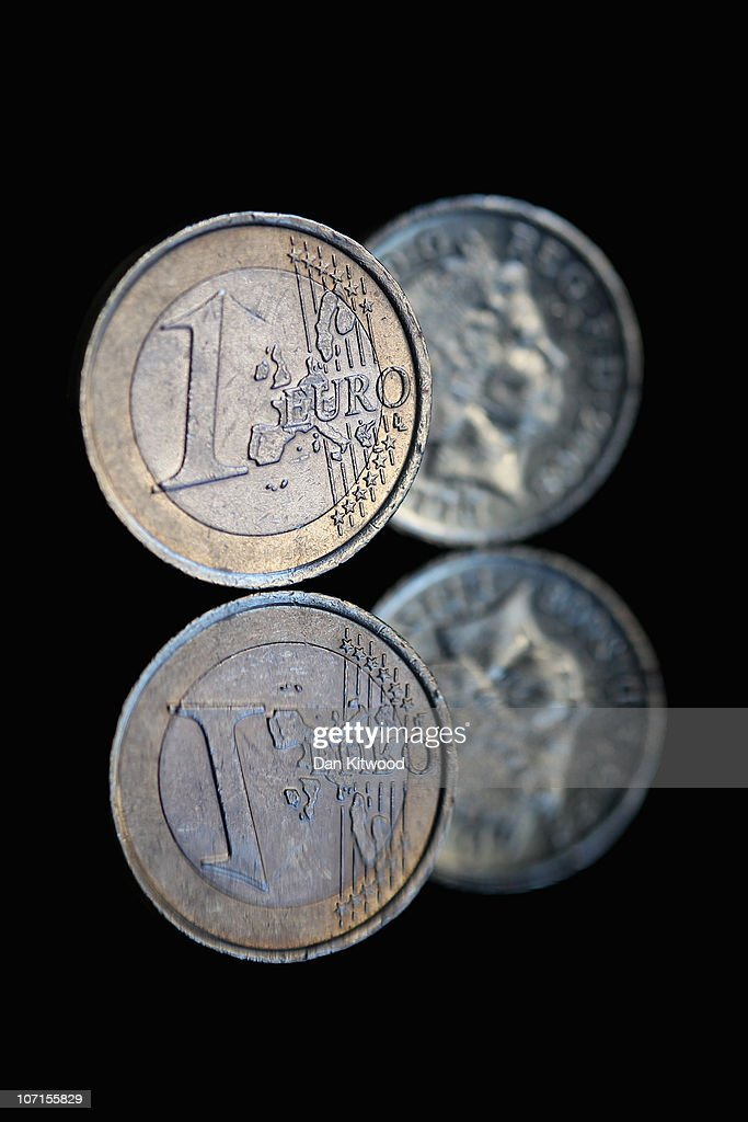 In this photo illustration a Euro coin and a GBP1 coin are displayed on on November 26 2010 in London England Concerns over the Euro zone debts have...
