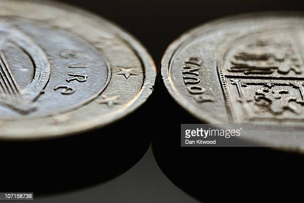 In this photo illustration a Euro coin and a GBP1 coin are displayed on November 26 2010 in London England Concerns over the Euro zone debts have...