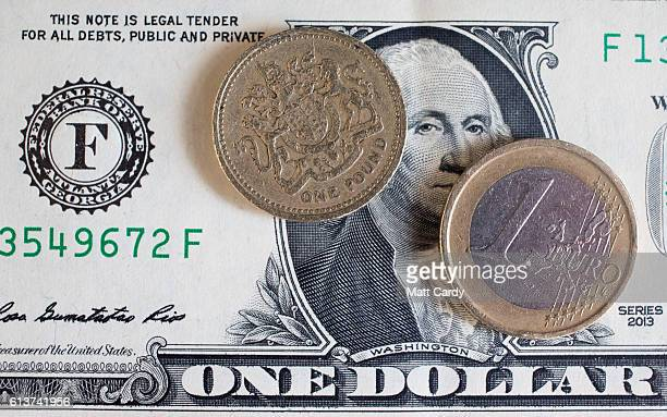In this photo illustration a Euro coin and a one pound sterling coin are seen on top of a US dollar bill on October 10 2016 in Bath England Since the...