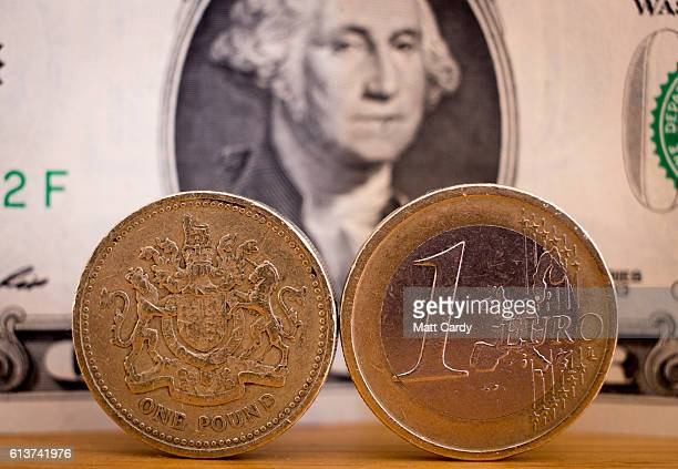 In this photo illustration a Euro coin and a one pound sterling coin are seen in front of a US dollar bill on October 10 2016 in Bath England Since...