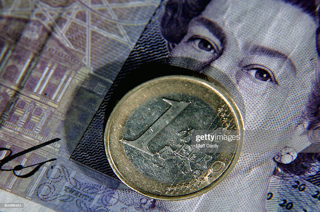 In this photo illustration a Euro coin is seen by a 20 GBP note on December 17, 2008 in Bristol, England. The British pound is currently at its lowest value ever against the Euro, trading below 1.10 Euros this morning, after it was revealed that the Bank of England considered a bigger interest rate than the one delivered two weeks ago.