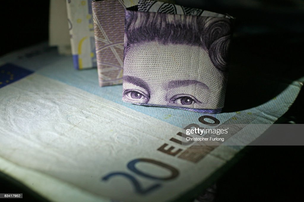 In this photo illustration a folded British 20 pound note sits next to a 20 Euro note on October 23, 2008 in Manchester, England. As markets across the globe continue to struggle the world wide credit crunch begins to bite deeper with fears of economic recession