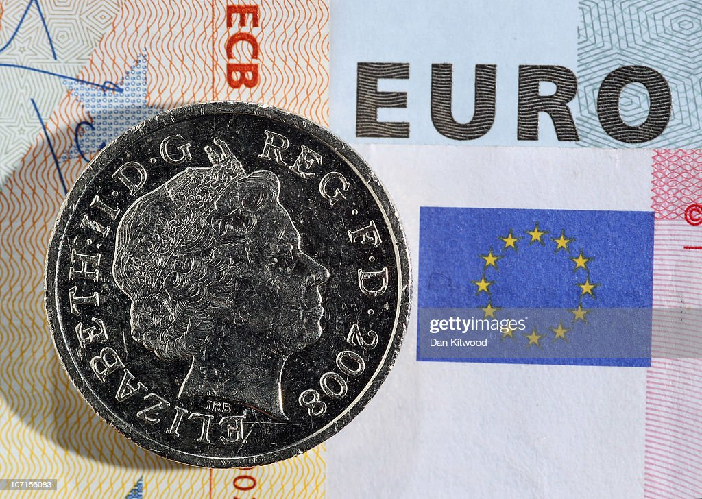 In this photo illustration a GBP1 coin sits on top of several Euro notes on November 26 2010 in London England Concerns over the Euro zone debts have...