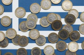 In this photo illustration a Greek flag is covered with one Euro coins on October 4 2011 in Berlin Germany Greek government officials announced the...