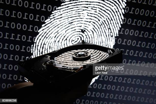 In this photo illustration a hard drive is seen in the light of a projection of a thumbprint on August 09 2017 in London England With so many areas...