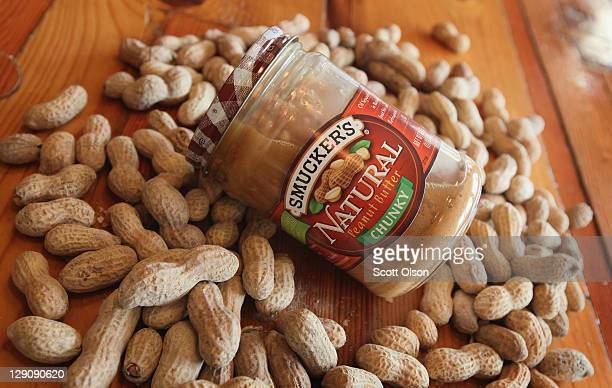 In this photo illustration A jar of Smucker's Natural peanut butter is pictured on October 12 2011 in Chicago Illinois This summer's hot dry weather...