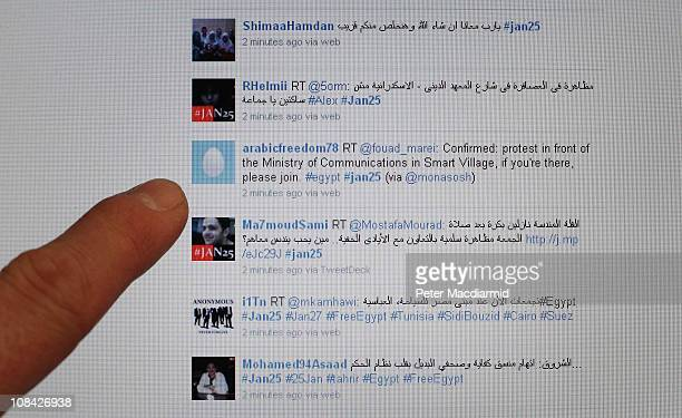 In this photo illustration a laptop computer displays a Twitter feed relating to Egyptian protests on January 27 2011 in Cairo Egypt People across...