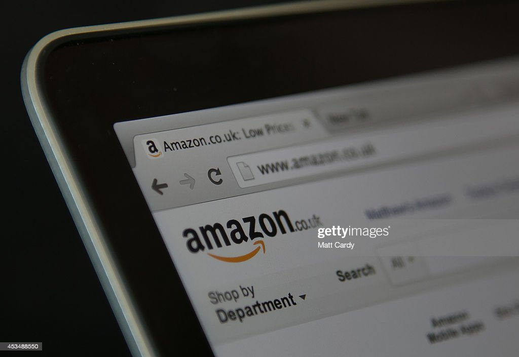 In this photo illustration a laptop displays the Amazon website on August 11 2014 in Bristol United Kingdom This week marks the 20th anniversary of...