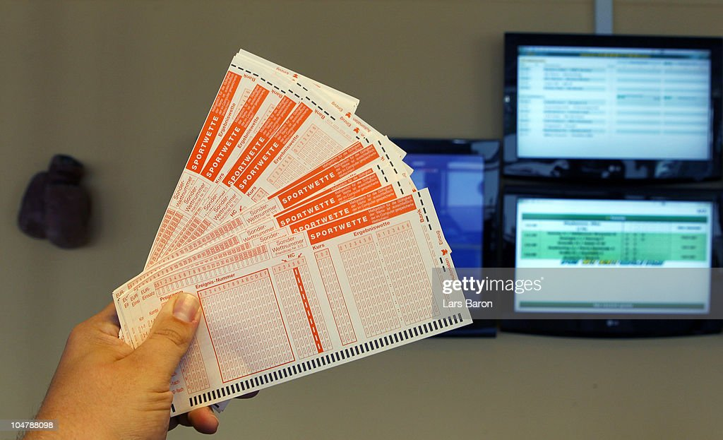 In this photo illustration a man holds betting slips in his hand in a sports betting office on October 5, 2010 in Germany.