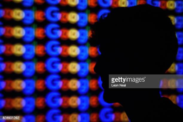 In this photo illustration A man is silhouetted against a projection of the Google logo on August 09 2017 in London England Founded in 1995 by Sergey...