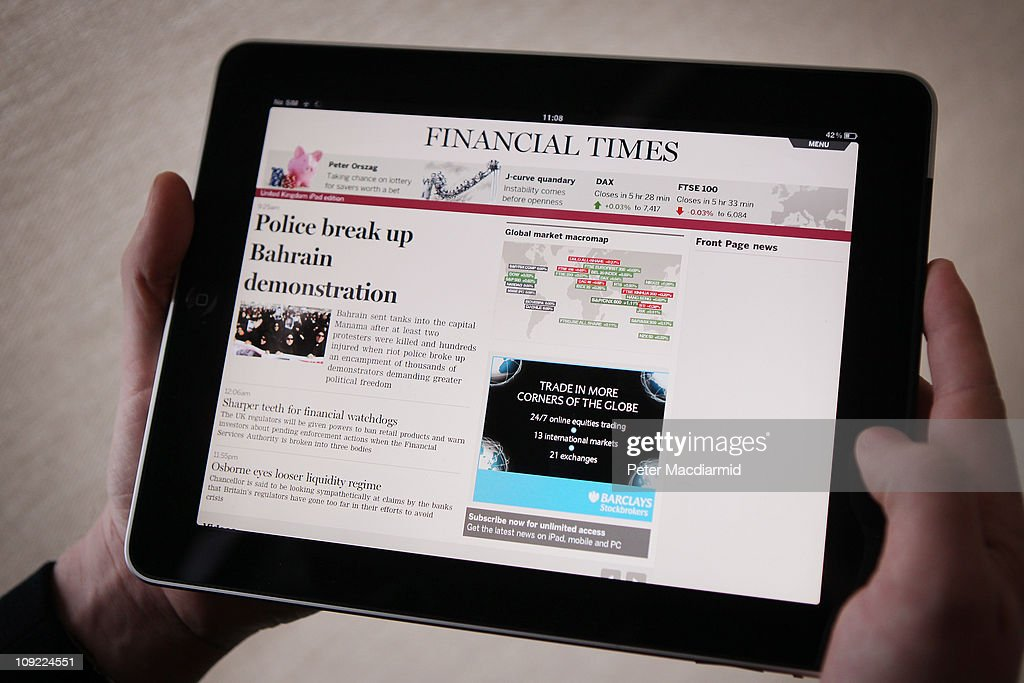 In this photo illustration, a man looks at The Financial Times app on an Apple ipad tablet on February 17, 2011 in London, England. Apple sold two million ipads in the first two months of their launch in 2010. Worldwide iPad sales are expected to amount to 20 million in 2012.