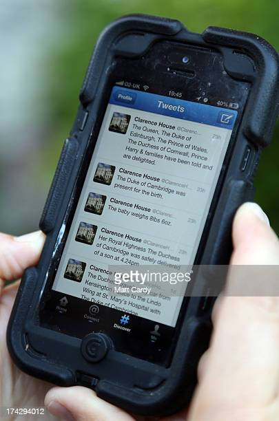 In this photo illustration a man looks at Twitter on a iPhone of tweets from Clarence House on July 23 2013 in Bristol England The Duchess of...