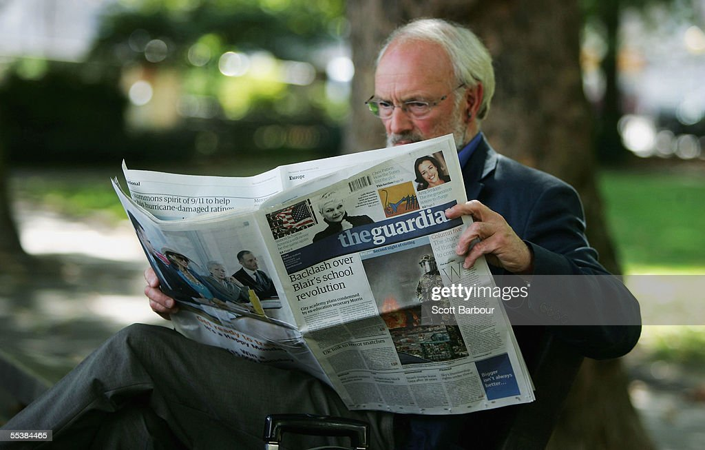 In this photo illustration a man reads a copy of The Guardian newspaper on September 12, 2005 in London, England. The Guardian has relaunched, changing from a broadsheet to mid-size format. The size, known as the Berliner, is half-way between a tabloid and a broadsheet.