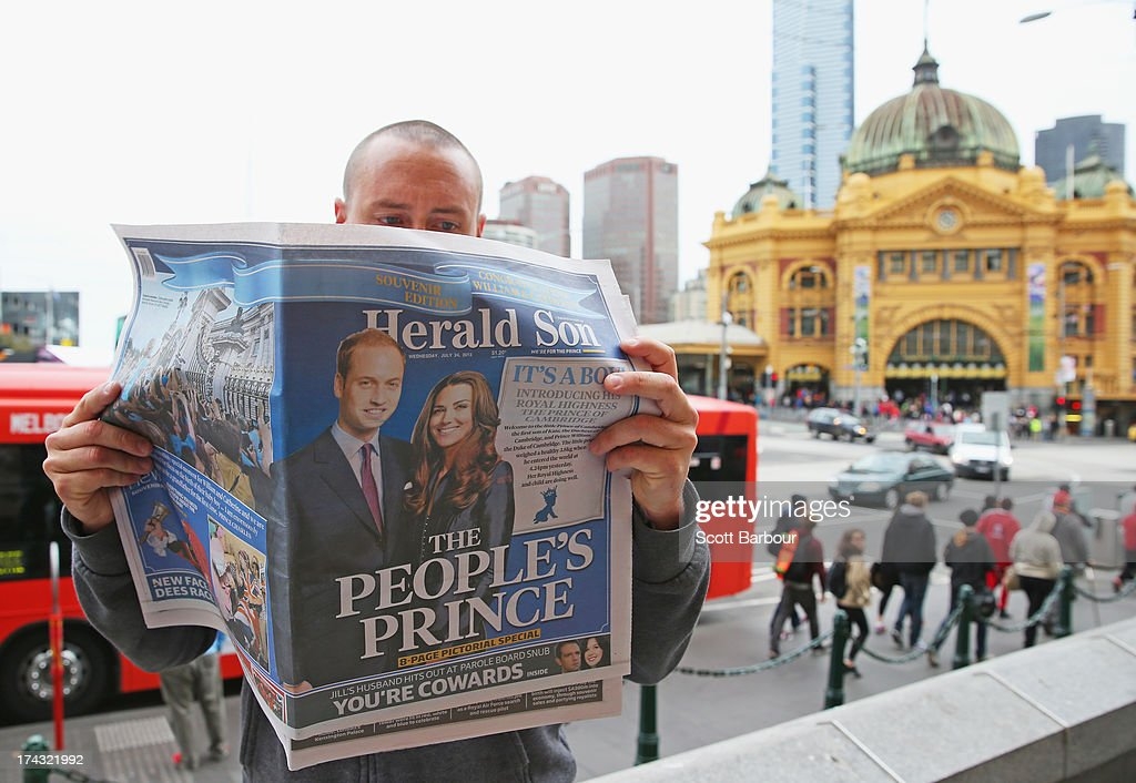 In this photo illustration, a man reads a copy of the local Melbourne newspaper 'The Herald Sun' showing the reaction to the birth of the Duke And Duchess Of Cambridge's new son, on July 24, 2013 in Melbourne, Australia. The Duchess of Cambridge yesterday gave birth to a boy at 16.24 BST and weighing 8lb 6oz, with Prince William at her side. The baby, as yet unnamed, is third in line to the throne and becomes the Prince of Cambridge.