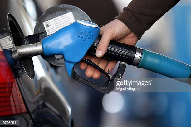 In this photo illustration a man refuels his car on March 23 2010 in Munich Germany German President Horst Koehler said higher petrol prices could...