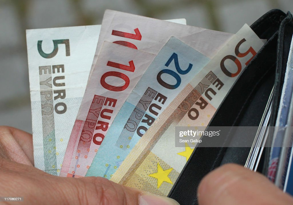 In this photo illustration a man removes Euro currency bills from a wallet on June 21, 2011 in Berlin, Germany. Eurozone finance ministers are currently seeking to find a solution to Greece's pressing debt problems, including the prospect of the country's inability to meet its financial obligations unless it gets a fresh, multi-billion Euro loan by July 1. Greece's increasing tilt towards bankruptcy is rattling worldwide financial markets, and leading economists warn that bankruptcy would endanger the stability of the Euro and have dire global consequences.