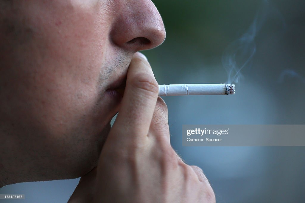 In this photo illustration a man smokes on August 1, 2013 in Sydney, Australia. In a plan announced today, the government will increase the excise on tobacco by 12.5 per cent annually over the next four years, raising over AUD$5 billion. The hike is estimated to increase the cost of cigarettes by AUD$5 by 2016, and is the first increase in the tobacco excise since 2010.