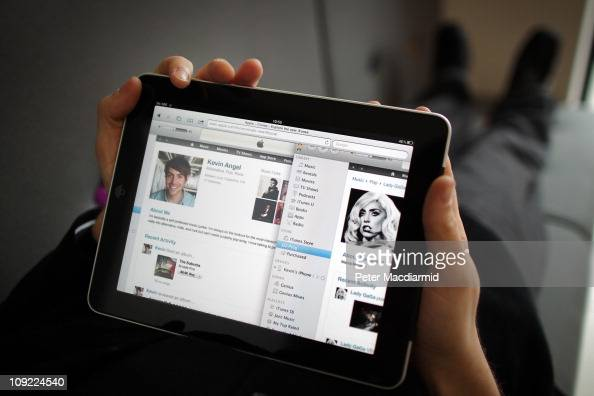 In this photo illustration a man uses an Apple ipad tablet on February 17 2011 in London England Apple sold two million ipads in the first two months...