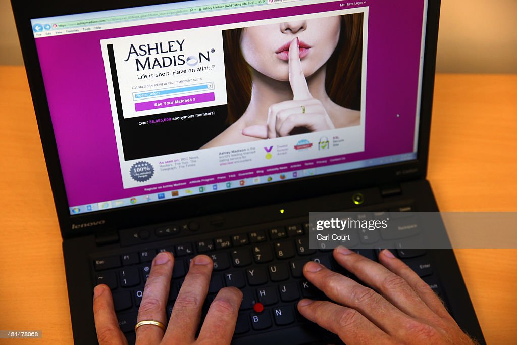 In this photo illustration a man visits the Ashley Madison website on August 19 2015 in London England Hackers who stole customer information from...