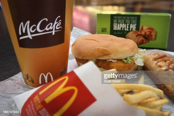 In this photo illustration a McChicken sandwich sits with typical Dollar Menu items sold at a McDonald's restaurant on October 24 2013 in Des Plaines...