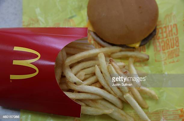 In this photo illustration a McDonald's cheeseburger and fries are displayed on a table at a McDonald's restaurant on December 8 2014 in Novato...