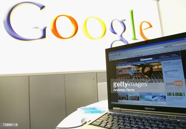In this photo illustration a monitor displays 'Clear Channel' website in front of a Google advertising at Hanover fair on April 16 2007 in Hanover...