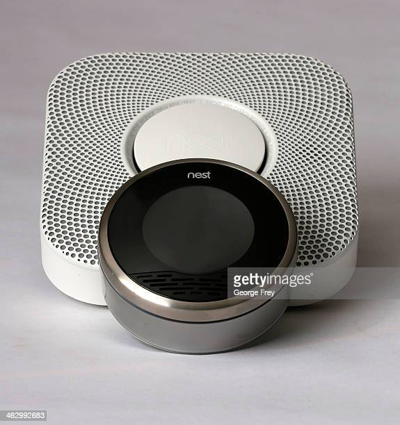 In this photo illustration a Nest thermostat and a smoke and carbon monoxide detector is seen on January 16 2014 in Provo Utah Google bought Nest a...