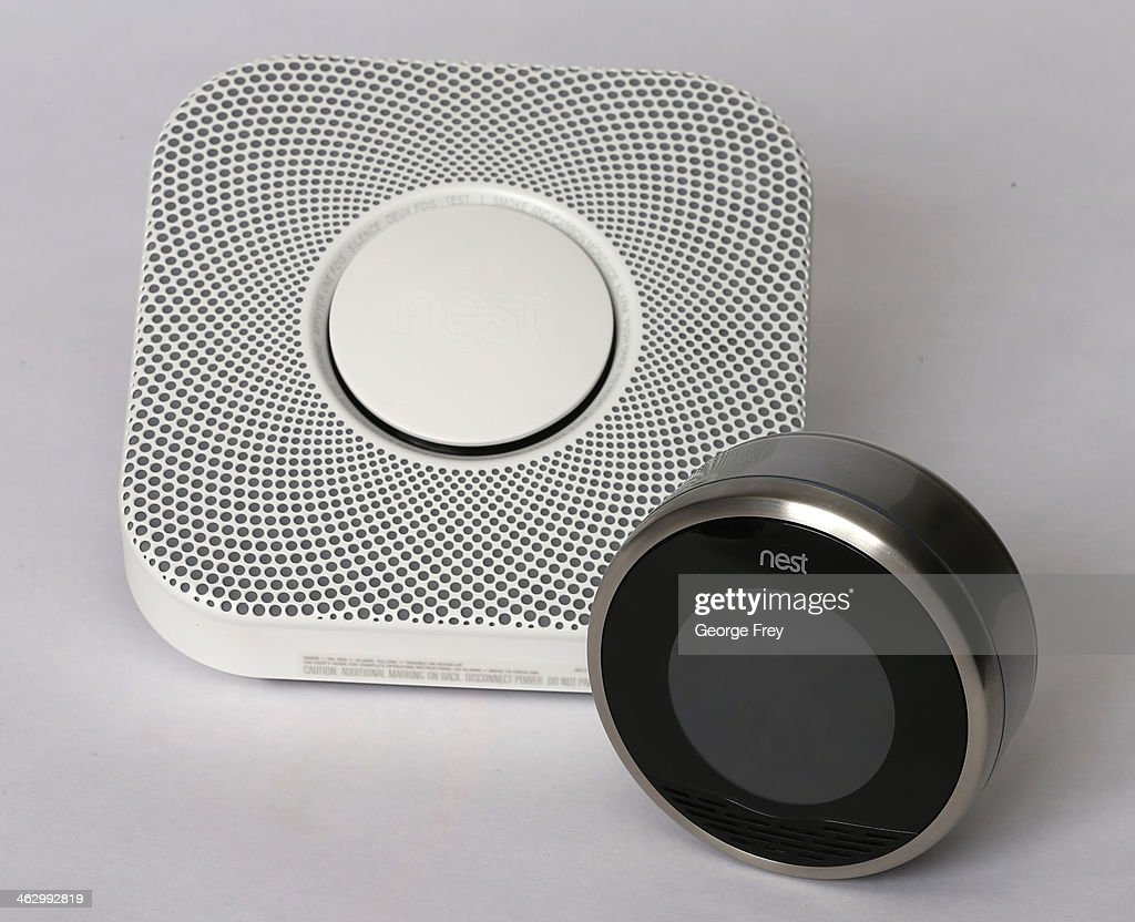 In this photo illustration, a Nest thermostat (R) and a smoke/carbon monoxide detector is seen on January 16, 2014 in Provo, Utah. Google bought Nest, a home automation company, for $3.2 billion taking Google further into the home ecosystem.