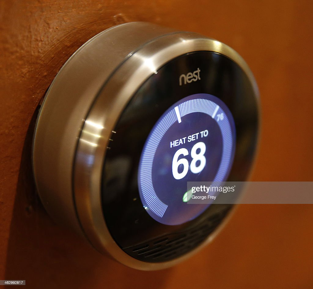 In this photo illustration, a Nest thermostat installed in a home is seen on January 16, 2014 in Provo, Utah. Google bought Nest, a home automation company, for $3.2 billion taking Google further into the home ecosystem.