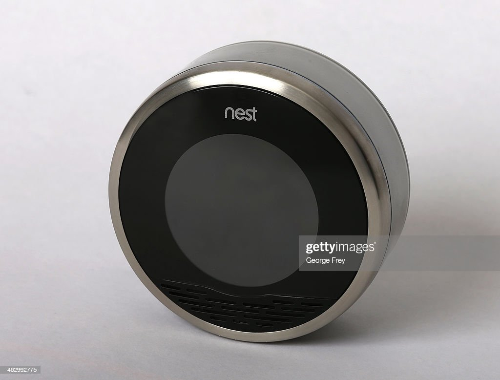 In this photo illustration, a Nest thermostat is seen on January 16, 2014 in Provo, Utah. Google bought Nest, a home automation company, for $3.2 billion taking Google further into the home ecosystem.
