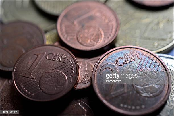 In this photo Illustration a one and two cent euro coin are shown on May 17 2013 in Brussels Belgium The EU are considering scraping the 1 and two...