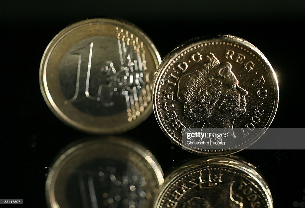 In this photo illustration a one Euro coin can be seen next to a British one pound coin on October 24, 2008 in Manchester, England. As markets across the globe continue to struggle the world wide credit crunch begins to bite deeper with fears of economic recession