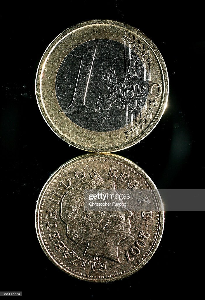 In this photo illustration a one Euro coin can be seen on top of a British one pound coin on October 24, 2008 in Manchester, England. As markets across the globe continue to struggle the world wide credit crunch begins to bite deeper with fears of economic recession