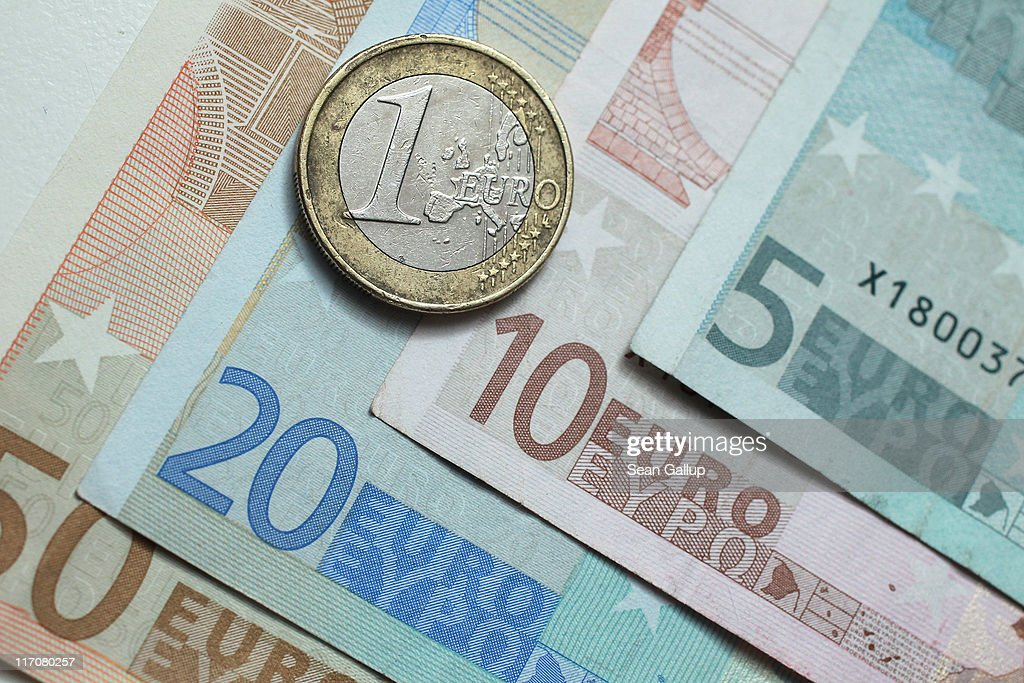 In this photo illustration a one Euro coin lies on Euro currency bills on June 21 2011 in Berlin Germany Eurozone finance ministers are currently...