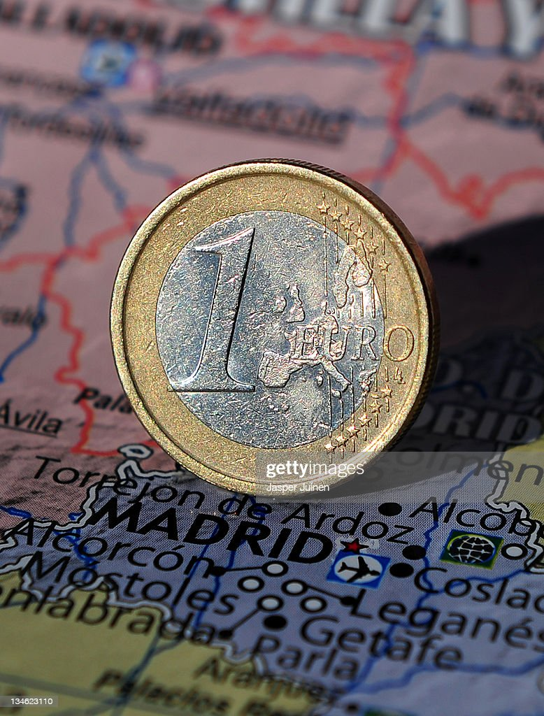 In this photo illustration a one Euro coin stands on a map of Spain showing the city of Madrid on November 16, 2011 in Madrid, Spain.