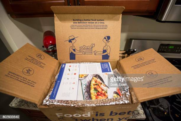 In this photo illustration a partially opened Blue Apron box sits on a kitchen counter on June 28 2017 in Boston Massachusetts The online mealkit...