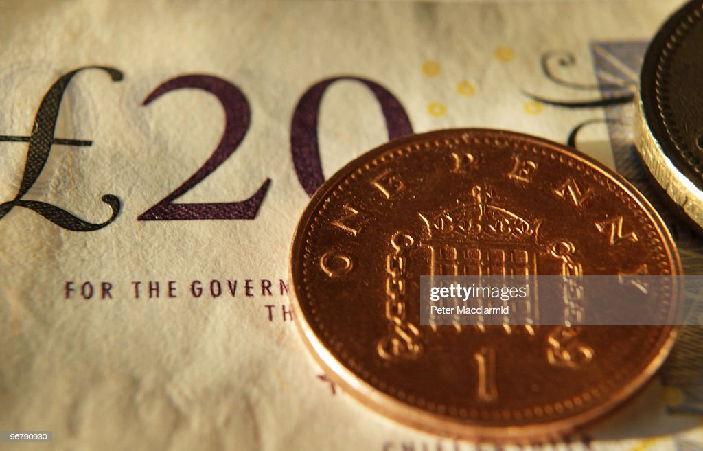 In this photo illustration a penny and £1 coin sit on a £20 note on February 17 2010 in London England As the UK gears up for one of the most hotly...
