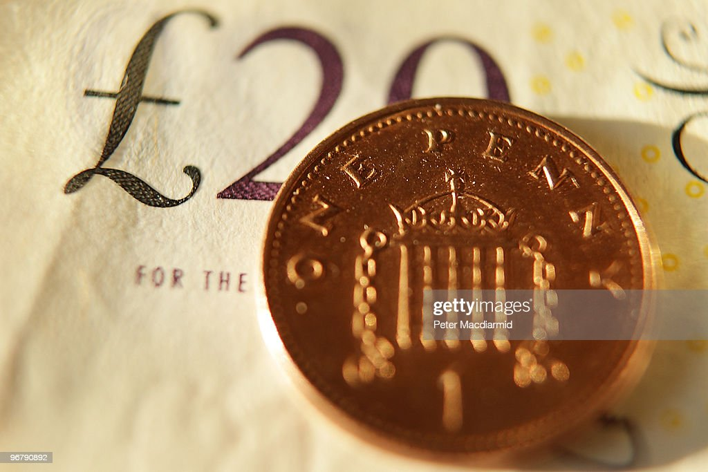 In this photo illustration a penny coin sits on a £20 note on February 17 2010 in London England As the UK gears up for one of the most hotly...