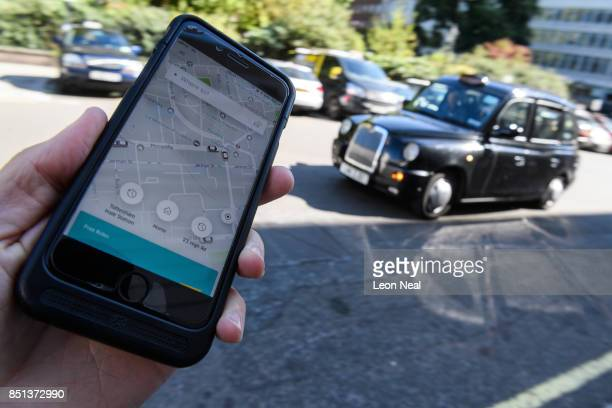 In this Photo Illustration a phone displays the Uber ridehailing app on September 22 2017 in London England The Transport Regulator has announced...