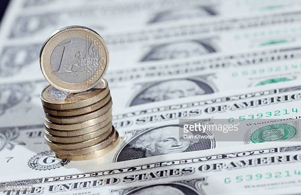 In this photo illustration a pile of Euro coins sit on a display of one Dollar notes on November 26 2010 in London England Concerns over the Euro...