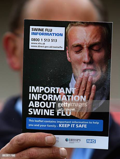In this photo illustration A postman delivers a leaflets giving information about swine flu to a home in Cromarty on May 5 2009 in Scotland Leaflets...