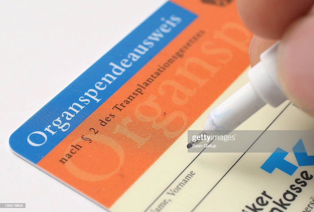 In this photo illustration a real organ donor's card (Organspendeausweis) from public health insurer Techniker Krankenkasse is seen on November 13, 2012 in Berlin, Germany. German health insurance companies are sending out the cards to their policy holders in an effort to get more people registered for organ donation. Demand for organs in Germany is high and waiting lists are long.