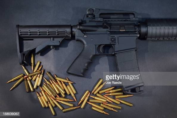 In this photo illustration a Rock River Arms AR15 rifle is seen with ammunition on December 18 2012 in Miami Florida The weapon is similar in style...
