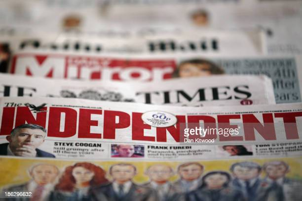 In this photo illustration a selection of UK national newspapers are displayed together on October 30 2013 in London England The publishers of UK...