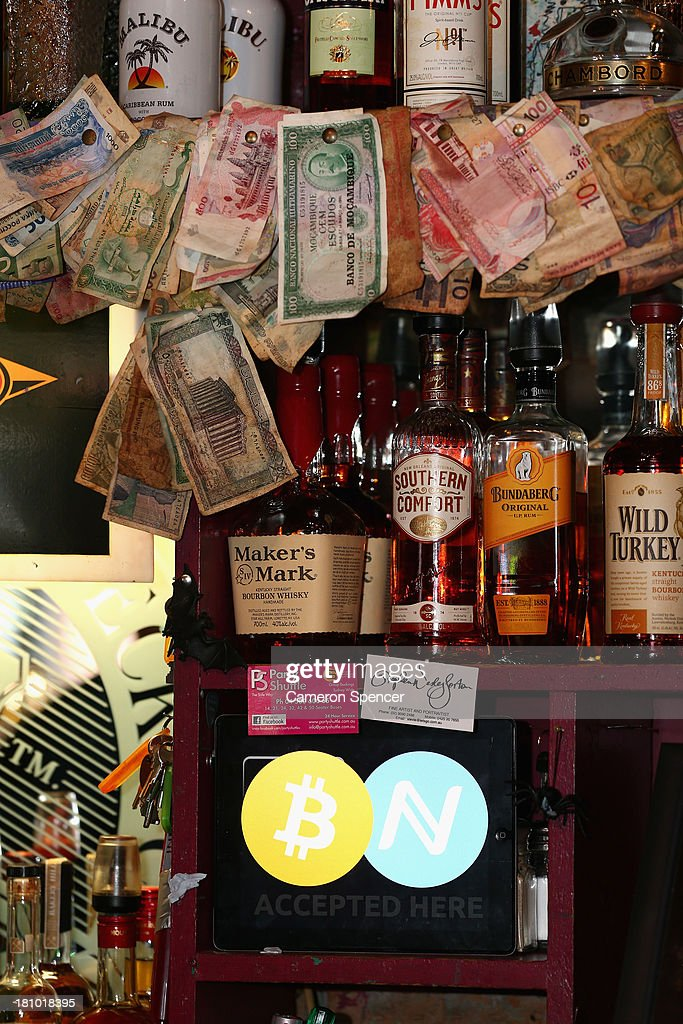 In this photo illustration, a sign saying bitcoins accepted is seen displayed behind the bar at the Old Fitzroy pub on September 19, 2013 in Sydney, Australia. The Old Fitzroy pub in Sydney's eastern suburbs will accept the digital currency, Bitcoin, as of Next Sunday. Using a smartphone and a QR code scanning application customers will be able to purchase beer and menu items at the bar. The Old Fitzroy is the first Australian pub to accept Bitcoin payment.