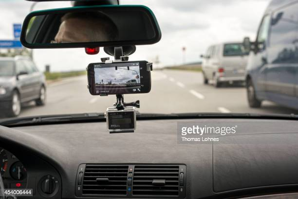 In this photo illustration a small action camera hangs attached inside the windshield of a car on August 23 2014 near Darmstadt Germany A German...