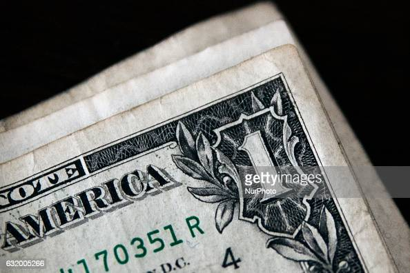 In this photo illustration a small stack of one US dollar bills is seen besides Pound Sterling notes on January 17 2017 in Bristol England Sterling...