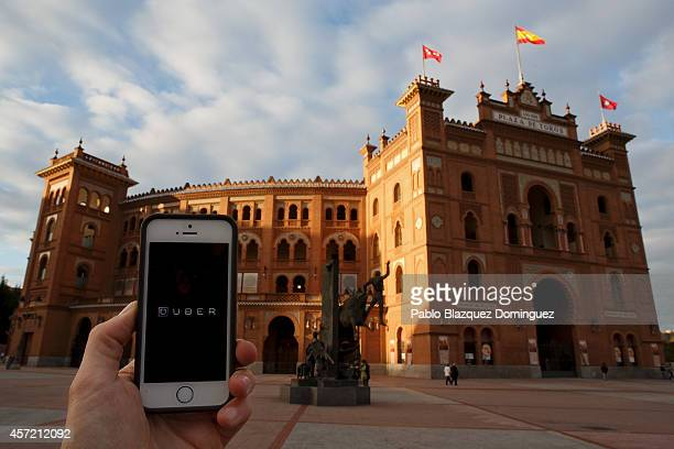 In this Photo Illustration a smart phone displays a picture with the logo of the news taxi app 'Uber' outside Plaza de Toros Las Ventas on October 14...
